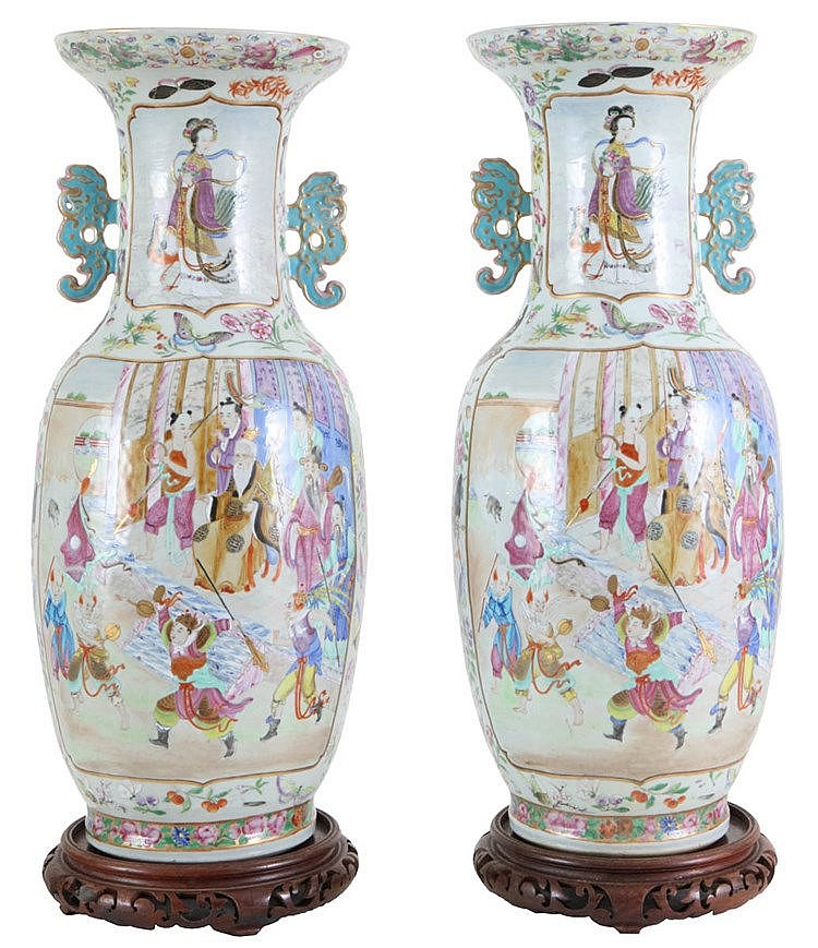 Pair of baluster Canton vases. Jia Qing period. Mandarin decor with court scenes on the body and female immortal on the neck. Circa 1830. Restorations.
