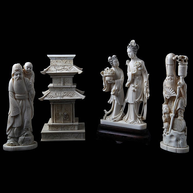 Lot of four various groups. Chinese ivory. Comprising a pagoda, two old wisemen with karako and a female immortal with servant.