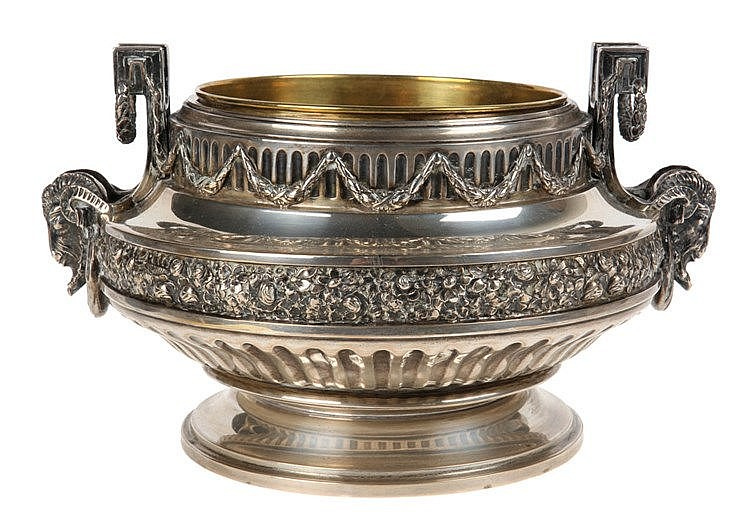 Louis XVI style Delheid center piece. Silver. Chased with ram's heads, garlands, roses and gadroons. Copper insert.