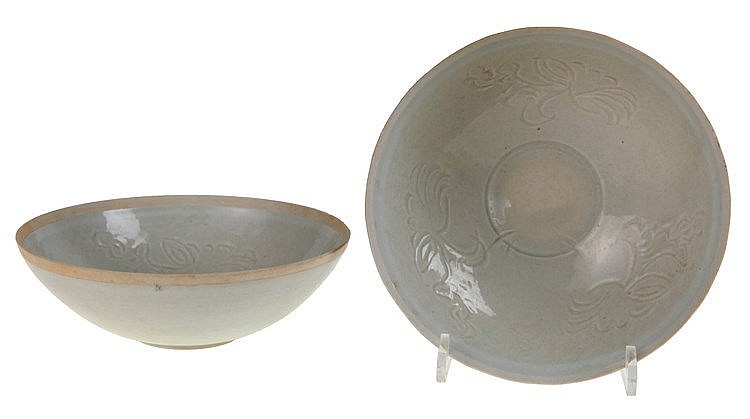 Pair of qingbai bowls. Light green glazed porcelain with engraved floral decoration. Upper rim not glazed. Probably Republic period after a model from the Southern Song Dynasty. One with minor hairline cracks underneath base.