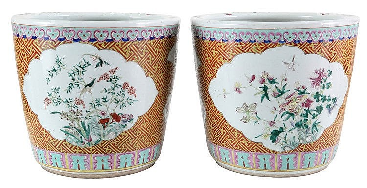 Pair of Chinese porcelain fishbowls. Famille rose decor painted with flowering twigs, birds and vases in various panels on orange ground with yellow geometrical shapes. 20th century work.