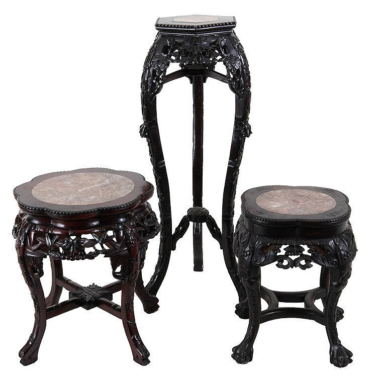 Set of three various stands. Carved and openwork ironwood. Chinese work. Various dimensions. One damaged.