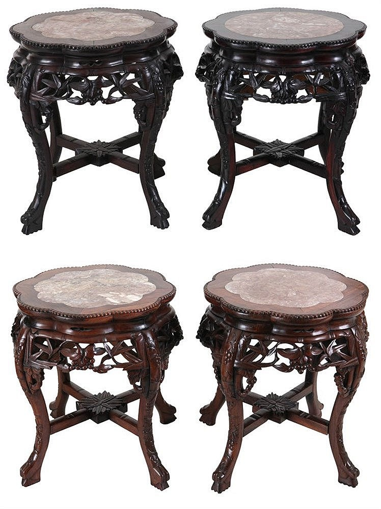 Two pair of low stands. Carved and partly openwork ironwood. Marble top. Four legs. Chinese work.
