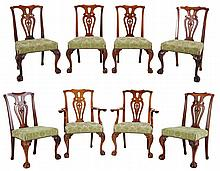 Chippendale style dining room garniture. Light mahogany and dark walnut. Comprising two arm chairs and six chairs. Olive green, partly imprinted velvet upholstery.
