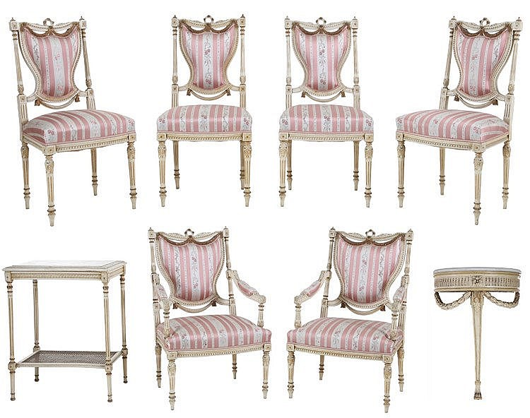 Louis XVI style eight-piece living room garniture comprising two armchairs, four chairs, a console table and a side table. Partly gilt white painted wood. Renewed striped silk upholstery.