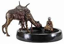 Black marble vide-poche with dromedary and rider in cold painted Viennese bronze.