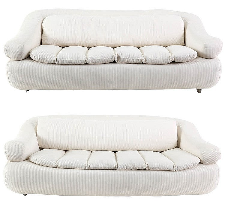 ANONYMOUS XX Pair of twoseaters, circa 1970. Broken white upholstery.