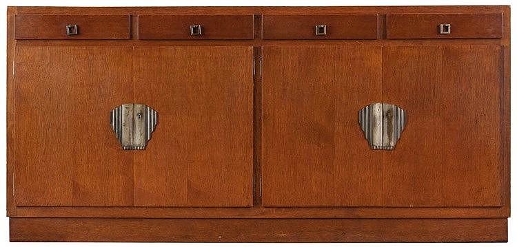 PAUL SMEKENS (1890-1983) circle Sideboard. Oak. Four doors and four dr