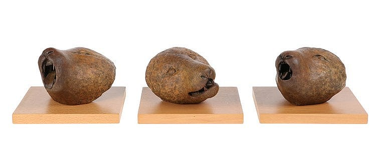 KEIKO YOSHIDA(1938) Wolf head. Bronze, light brown patina. A set of th
