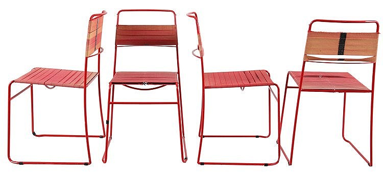 ANONYMOUS XX Set of four chairs. Circa 1980. Red painted metal. Red fa