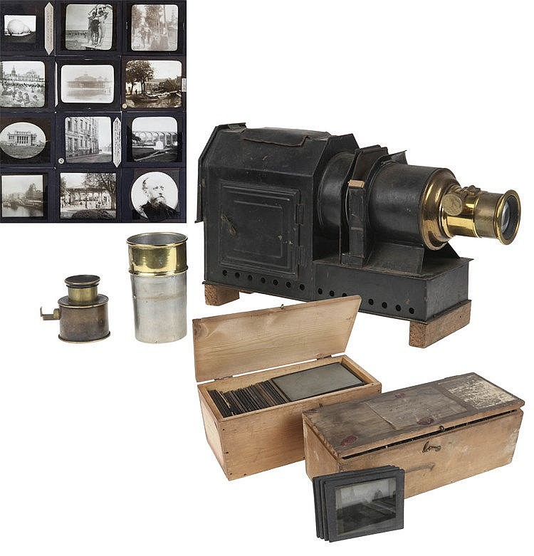 Small portable projecting device. Together with 60 square glass negatives,