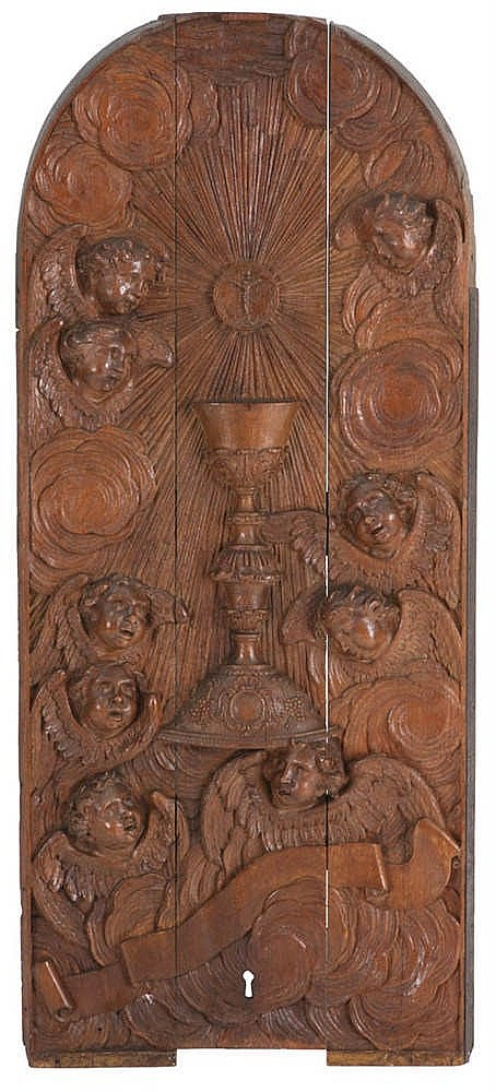 Bas relief carved with a chalice surrounded by angels oak
