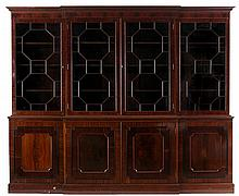 Breakfront bookcase. Light and dark walnut. Straight moulded cornice above four doors. Four panelled doors in the lower part inlaid with ebonised wood banding. English work. Victorian period.