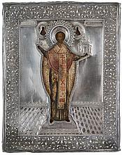Icon of Saint Nicholas of Mozhaisk in architectural surroundings. Tempera on panel. Russia, 18th century. Silver oklad with applied decor of grapevines, maker's mark IZ (in Cyrillic), dated 1868. Age cracks.