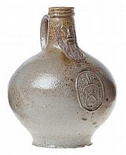 Cologne/Frechen so-called 'bartmannkrug' or bellarmine jug. Grey and partly brown glazed stoneware. Circa 1600. The globular body applied with a medallion depicting a lion rampant.