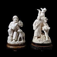 A set of two various groups depicting a farmer's couple with a cow and a shepherd with lams. Carved ivory. Chinese work.