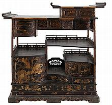 Cabinet. Brown lacquered wood. Nine doors, six drawers. Parcel-gilt decoration in relief depicting figures and birds in a landscape. Copper mounts. 20th century Japanese work.