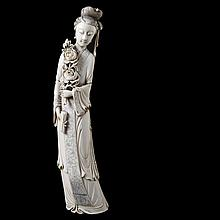 Female immortal with rose branch and scroll. Carved ivory. Chinese work.