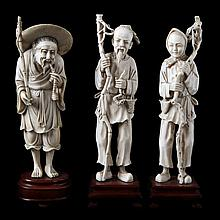 Lot of three various carved ivory figures comprising a farmer's couple (h.: 21) and on old fisherman with hat (h.: 20). Chinese work. Ironwood stands.