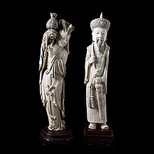Lot of two various figures in carved ivory of an emperor with sword and a female immortal with reversed flower basket. Chinese work. Wooden stands.