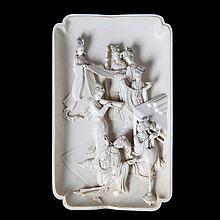 Ivory dish carved in relief with a court scene with seven female figures. Chinese work.