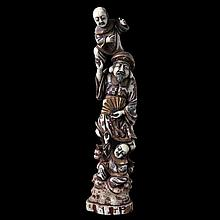 Daikoku with two servants on rock. Parcel polychrome, gilt and carved ivory. Marked. Japanese work.