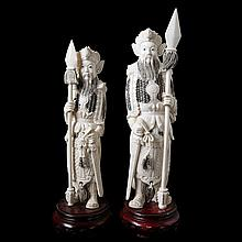 Pair of almost indentical guards with spear. Carved ivory. Chinese work. Woorden stands.