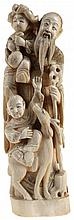 Old wiseman with staff, deer and two karako. Carved ivory. Japanese work.