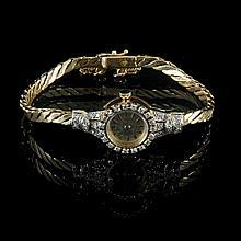 Ladies' wrist watch (1960). Bicolor gold, 21.8 g brut. Set with 40 8/8 diamonds, 0.8 g, quality G SI2.