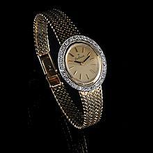 Entourage ladies' wrist watch Orlian, winding mechanism. Bicolor gold, 29 g brut. Set with 24 8/8 diamonds, 0.42 ct, quality H SI2.