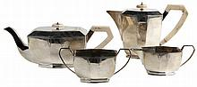 Four-part coffee and tea service of octagonal shape. Silver. Comprising a coffee pot, a tea pot, a sugar pot and a milk jug. The coffee and tea pots with ivory finial and handle. Marks for Edward Viner, Sheffield and London, 1935.