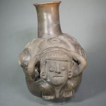 Late Chavin Single Spout Vessel of a Figure Carrying a Burden of Plates