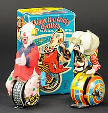 TWO CLOWN WIND-UP TOYS