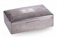 AN ART DECO SILVER PRESENTATION CASKET