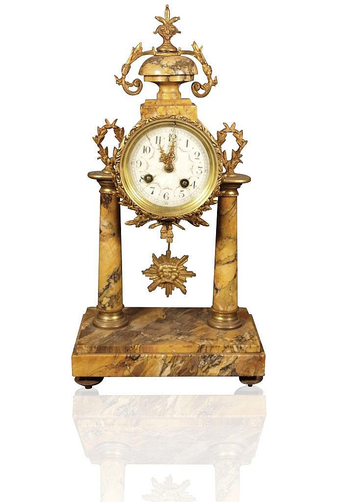 A decorative French mantle clock