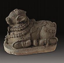 A GREY STONE SITTING NANDI (BULL), South-India, 17th century,