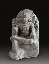 A GRANITE FIGURE OF SHIVA AS THE GREAT TEACHER - DAKSHINAMURTI, Chola Dynasty, South-India, 13th century,