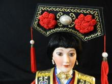 """Lot 115: 19"""" Korean Doll on wood stand"""