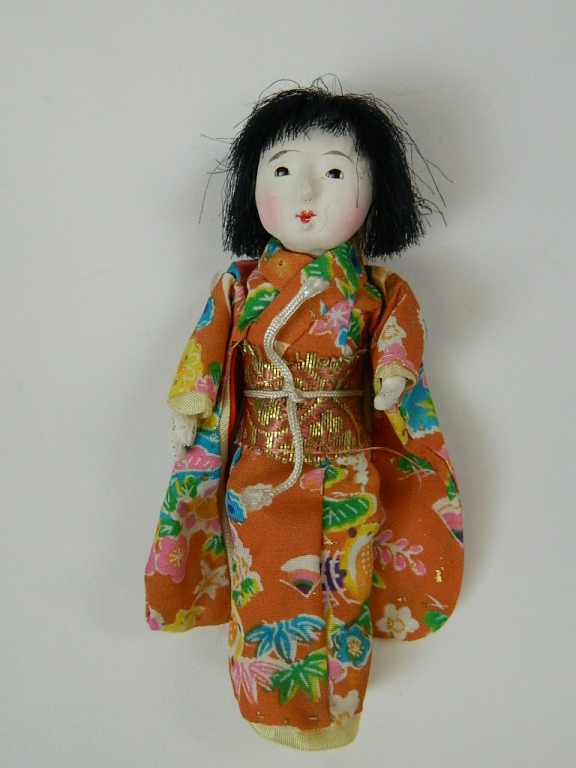 Lot 149: Japanese Doll with Assorted Wig Set