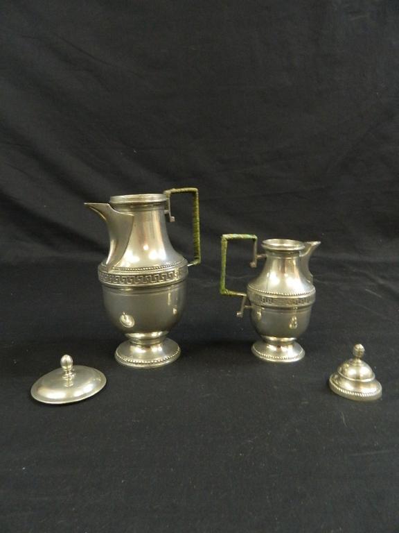 Lot 181: Egyptian Pattern SilverPlated Coffee Pot & Creamer