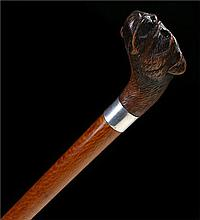 Early 20th Century finely carved dog head walking stick, the carved Victori