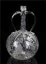 18th Century glass decanter, the slender neck with a pair of arched handles