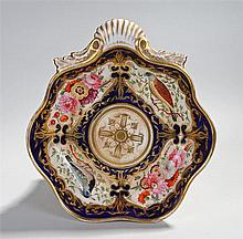 Circa 1810 shell shaped dish with blue ground and with gilding, four panels