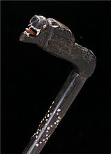 Indian walking stick with inlaid decoration the handle carved as a stylized
