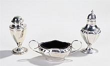 Silver objects, to include a bun pepper, London 1934, silver salt with flut