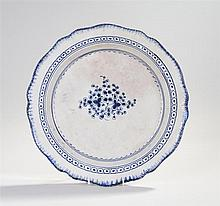 Early 19th Century creamware dish, with blue painted leaf border, blue circ