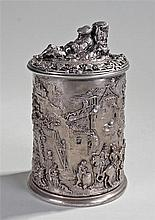 Silver plated tobacco jar with a reclining man to the lid above raised deco
