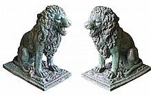 Pair of bronzed lions, of large proportions, each in a seated position with