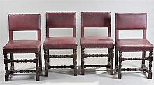 Set of four Cromwellian style oak chairs with pad back and seat above the t
