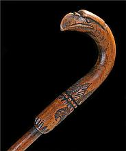 Early 20th Century oak poker stick, the carved eagle head above the interna